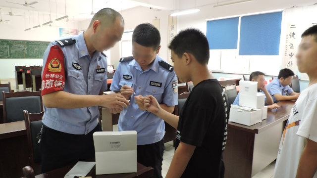 Officers from Shifang city public security bureau