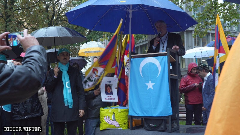 Phil Bennion, a British Liberal Democrat member of the European Parliament, gives a speech at the rally in Brussels.