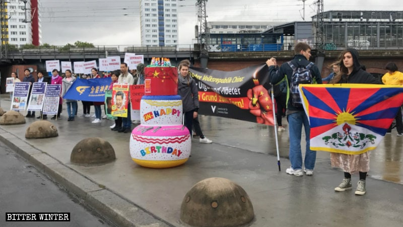 "Protestors in Berlin prepared an ""Unhappy Birthday"" cake for the National Day."