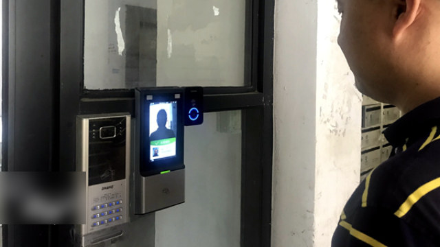An access control system with facial recognition at a residential community in Hangzhou city's Xihu district.