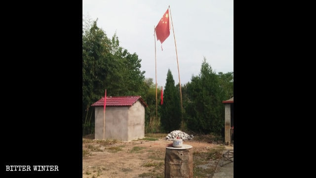 A torn national flag flying outside the closed down Fulin Temple.