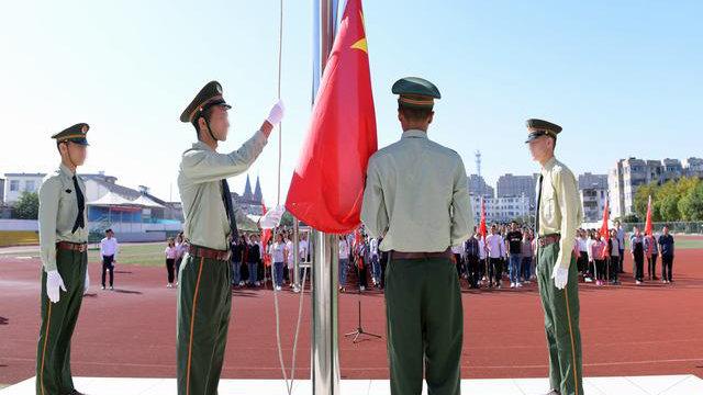 Xinjiang students at Kou'an High School in Jiangsu take part in a flag-raising ceremony.