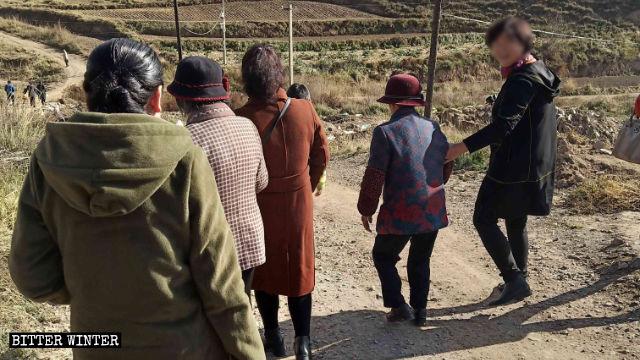 Believers traverse mountain roads
