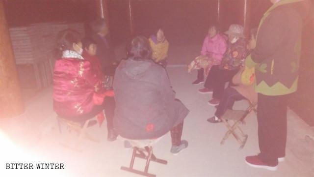 Elderly Christians are gathering in a gazebo