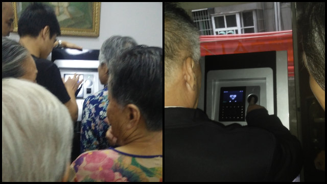 Elderly believers are queuing to have their fingerprints taken at a church