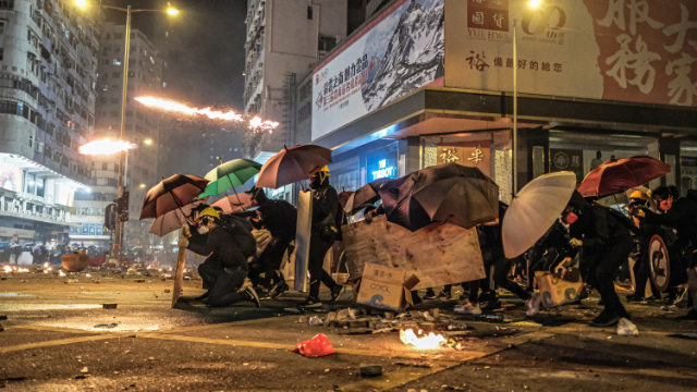 Hong Kong protestors are defending themselves against tear gas attacks by the police. (Studio Incendo - CC BY 2.0)
