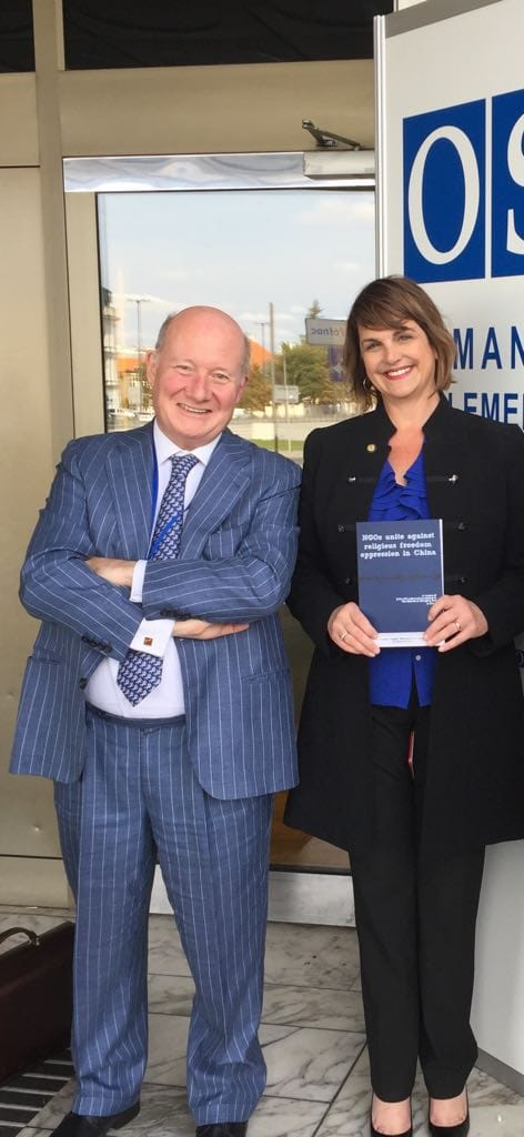 Former USCIRF Commissioner and Vice-Chairperson Kristina Arriaga with Bitter Winter's editor-in-chief Massimo Introvigne. Arriaga holds in her hands a collection of documents denouncing CCP atrocities against The Church of Almighty God.