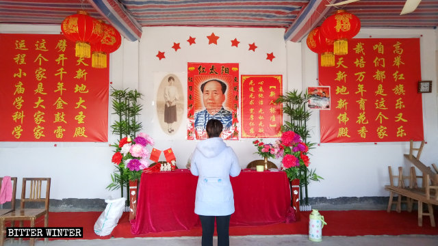 A portrait of Mao Zedong is posted inside a temple in Anliang town.