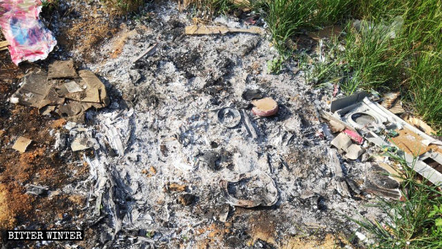 Ashes left behind after the statue of the Virgin Mary has been burned.
