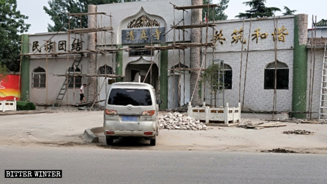Pillars and domes at the entrance to the mosque have been demolished.