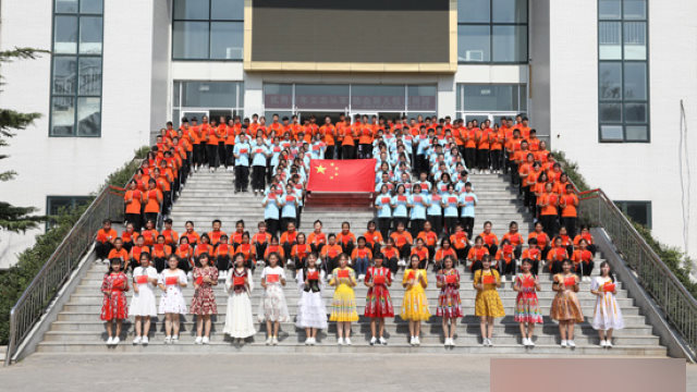 A flag raising ceremony held by Xinjiang students