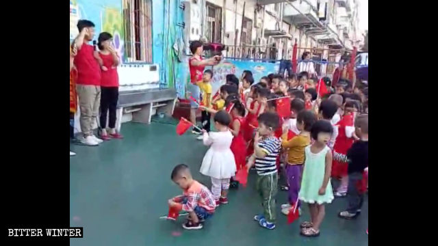 Children in a kindergarten swear allegiance to the motherland.