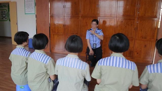 A prison guard indoctrinates female inmates.