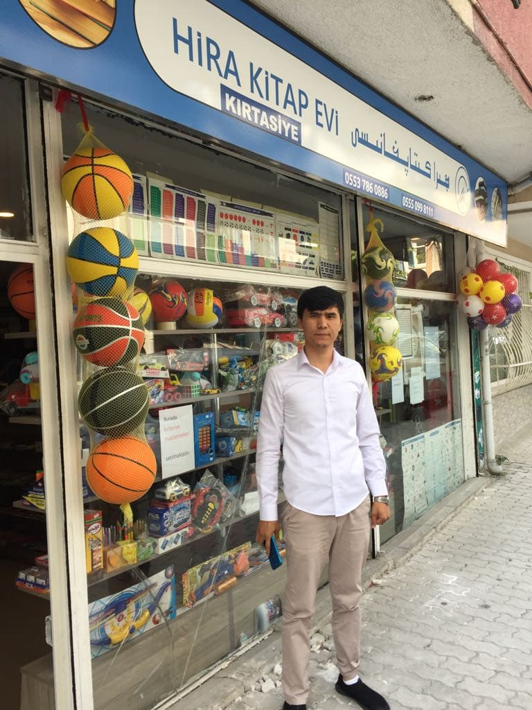 Omerjan Abdullah in front of his shop in Istanbul
