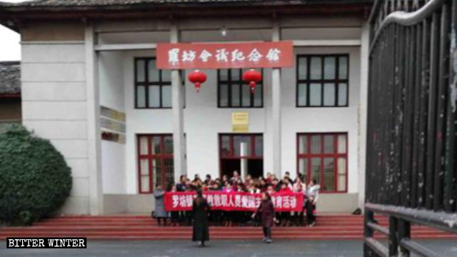 The congregation of a Three-Self church outside the Luofang Meeting Memorial Museum.