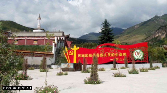 A large propaganda board with quotes from a Xi Jinping speech displayed outside Youning Temple in Qinghai Province.