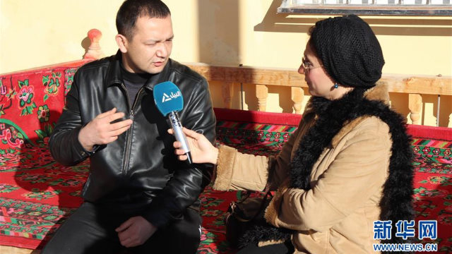 A Nile TV announcer is interviewing a villager
