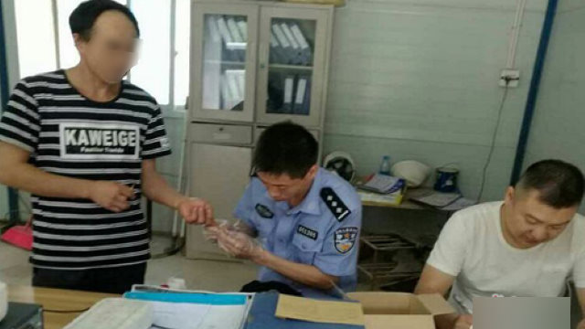 A police officer is collecting residents' blood samples