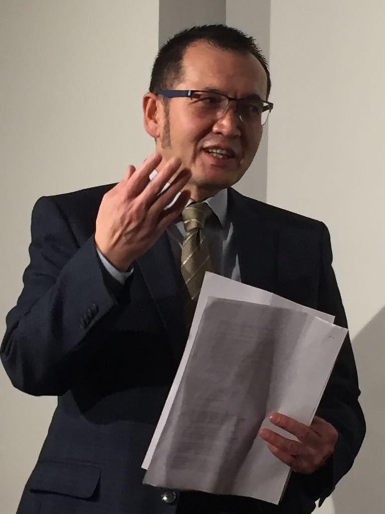 "Aziz Isa Elkun reading his poem, ""I Ask Spring to Come."""