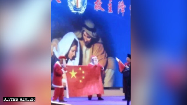 An actor playing Santa Claus holds the Chinese flag during the performance.
