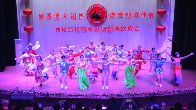 Xinjiang Students from No. 14 Middle School in Harbin city in a performance during New Year's celebrations.
