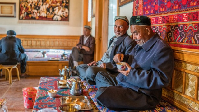 "CCP propaganda at work: an old image of Uyghur men in a coffee shop is used as ""evidence"" that all is well in Xinjiang"