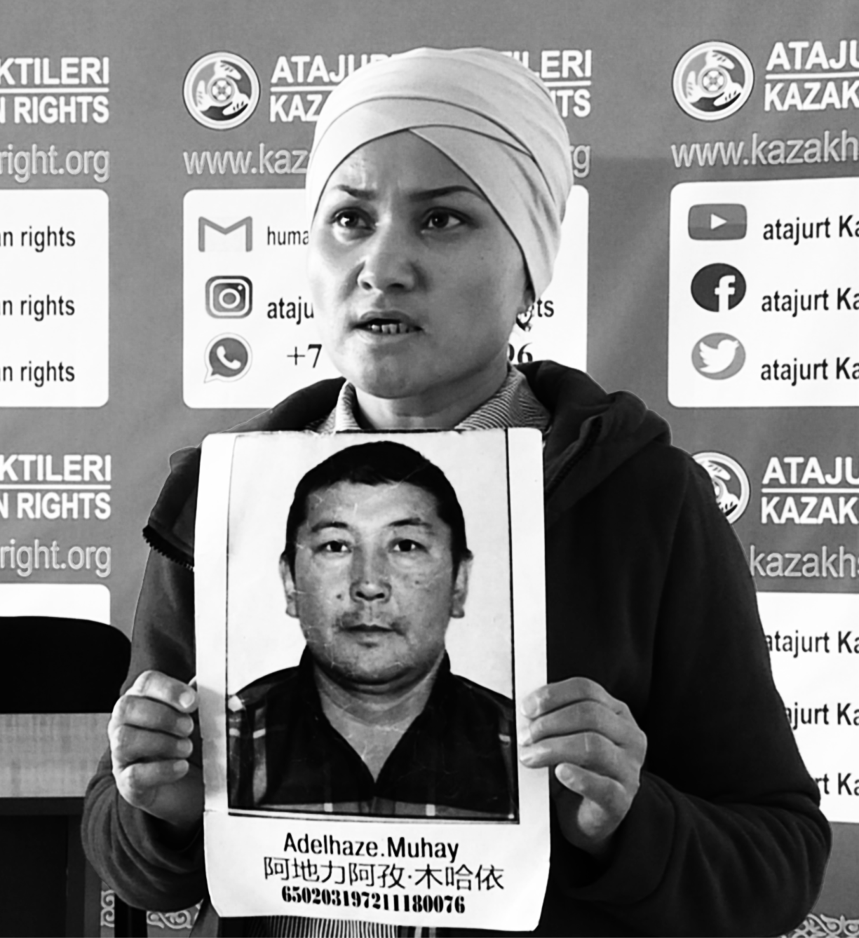 The mother of two children, Bikamal Kakenkyzy holds a picture of her husband.