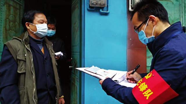 A grid administrator in the Wuming district of Nanning city in Guangxi Zhuang Autonomous Region registers residents' information during the coronavirus epidemic.