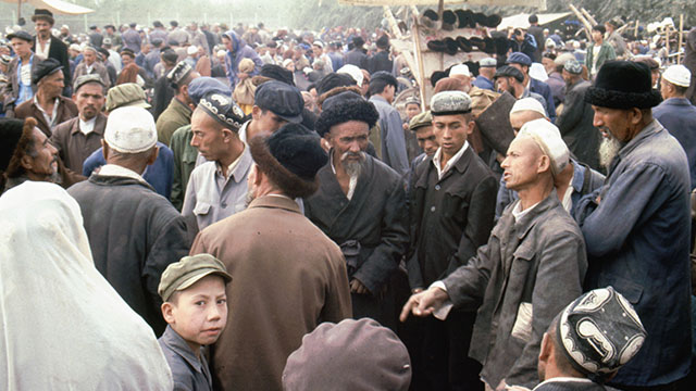 Uyghurs and Han Chinese at a market in Kashgar