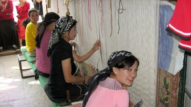 Khotan (Hotan / Hetian) is an oasis city in the Xinjiang Uygur Autonomous Region of the People's Republic of China. Carpet factory.
