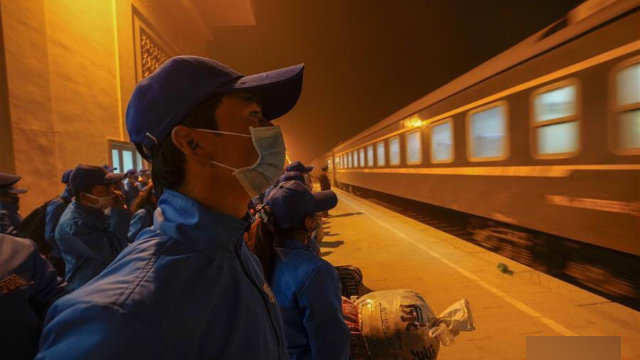 Workers at a railway station in Hotan's Moyu county