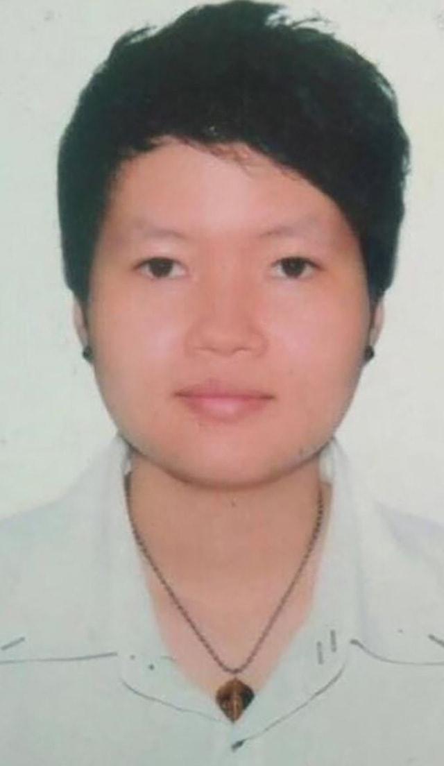 A police mugshot of Hà