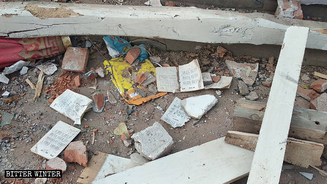 Hymnbooks scattered amid the ruins of the demolished church.
