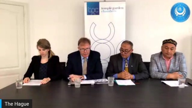 Mr. Rodney Dixon, QC, speaking from the Hague during the submission of evidence against the CCP for genocide and crimes against humanity. Far right is Omer Bekali, a key witness as a camp survivor.