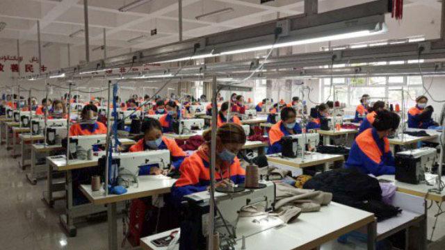 Uyghur women working in a clothing factory in Xinjiang's Xinyuan county.