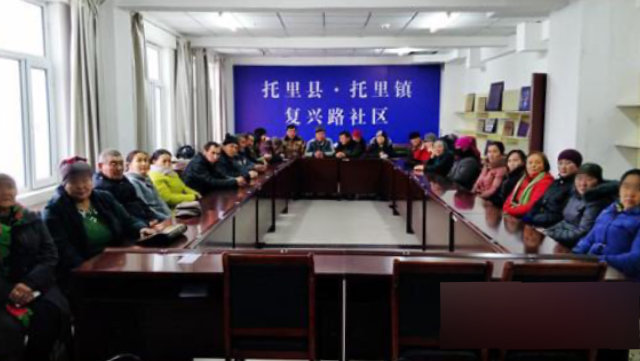 Xinjiang residents participate in an indoctrination class