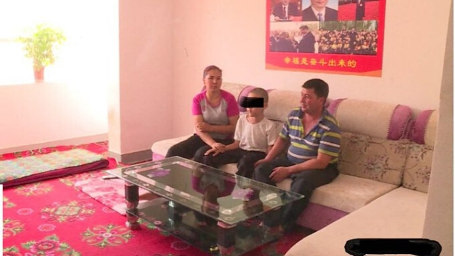 "The house has been ""sinicized,"" with cheap sofas and table, and Xi Jinping has replaced the religious symbols (posted by Prof. Grose on Twitter)."