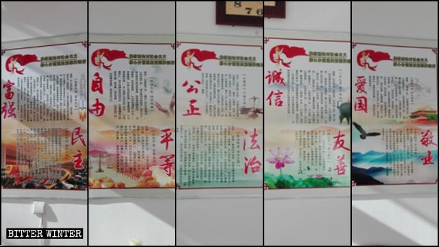 Propaganda boards comparing Buddhist scriptures and the core socialist values.