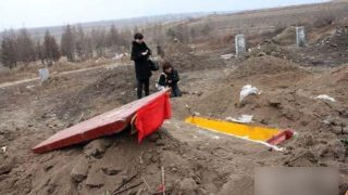 Officials Exhume and Burn Bodies to Promote Cremation