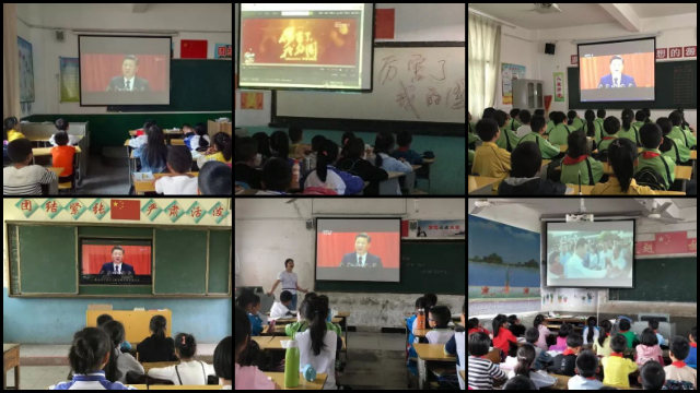 Children are watching Amazing China, a patriotic film, in school.