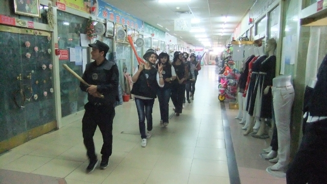 Home guard patrol wielding baseball bats in a Hotan shopping precinct. Photo by Ruth Ingram.