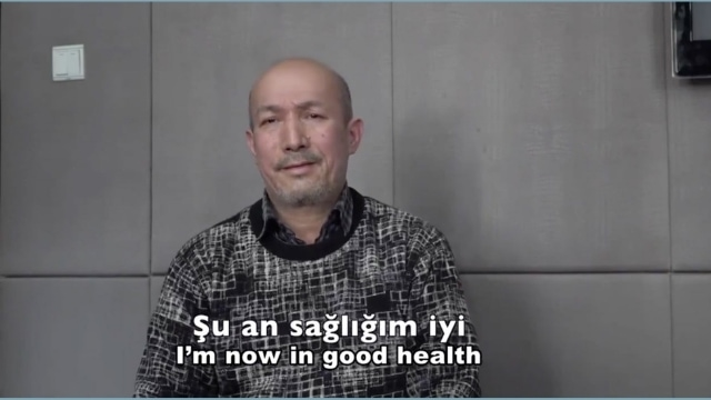 """""""I am now in good health"""": screengrab from a video of Heyit released by China Radio International's Turkish service."""