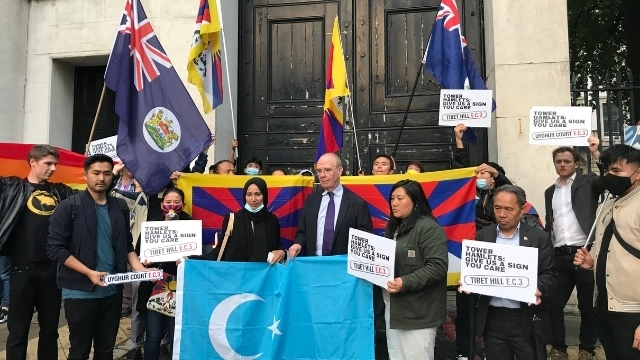 Centre left holding the East Turkestan flag Tower Hamlets' councilor Rabina Khan, and on her right, councilor Peter Golds.